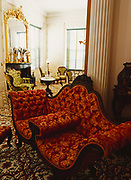 """A Tete-a-tete Sofa, French word meaning """"Head to Head"""", also known as a Courting Couch, furnishings in Melrose, Natchez National Historical Park, Natchez National Historical Park, Mississippi."""