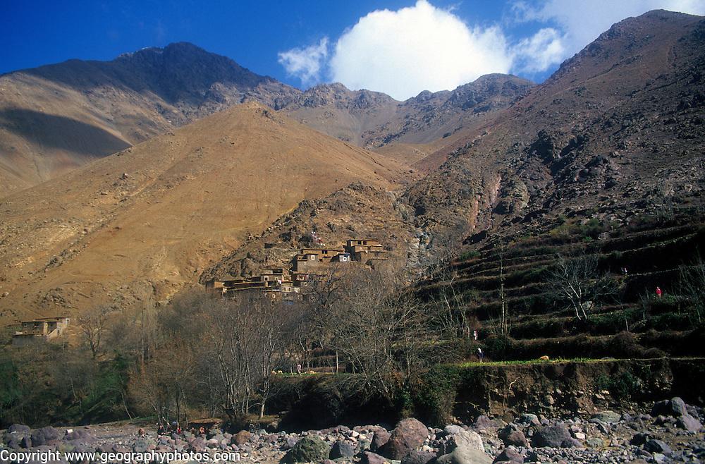 Berber village and farm terrace on steep mountain side, Atlas Mountains, near Imlil, Morocco
