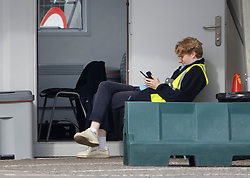 © Licensed to London News Pictures. 16/09/2020. Chessington, UK. A worker sits down at a Coronavirus testing centre set up in a car park at Chessington World of Adventures, south west of London. Only a trickle of people have arrived by car so far this morning. The Government have been criticised as people are facing delays getting tested for the virus. Photo credit: Peter Macdiarmid/LNP