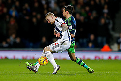 James McClean of West Bromwich Albion is challenged by Jack Cork of Swansea City - Mandatory byline: Rogan Thomson/JMP - 02/02/2016 - FOOTBALL - The Hawthornes - West Bromwich, England - West Bromwich Albion v Swansea City - Barclays Premier League.