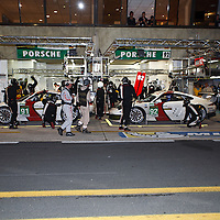 #91 #92 Porsche 911 RSR call into the pits at the end of the practice session on Thursday, 20 June 2013 at Le Mans 24H