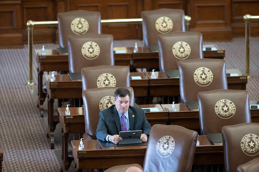 State Rep. Ken King, R-Amarillo, sits in the Texas House chamber Republican members mill about the chamber on the second day of failing to get a quorum at a special session. Most Democratic members left the state protesting of restrictive voting measures proposed byTexas Gov. Greg Abbott.
