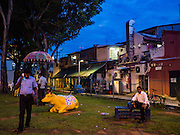 27 DECEMBER 2016 - SINGAPORE:   A park with a sculpture of a cow in the Little India section of India.     PHOTO BY JACK KURTZ