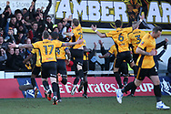 Shawn McCoulsky of Newport county (15) celebrates with his teammates and Newport fans after he scores his teams 2nd goal to make it 2-1.. Emirates FA Cup , 3rd round match, Newport county v Leeds Utd at Rodney Parade in Newport, South Wales on Sunday 7th January 2018.<br /> pic by Andrew Orchard,  Andrew Orchard sports photography.