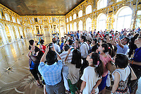 Hundreds of tourists barely fill the 1,000 meter square Hall of Light at the Catherine Palace at Tsarskoe Selo (Pushkin) near St. Petersburg, Russia.
