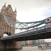 Tower Bridge And Tour Boat - London
