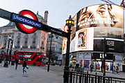 A government NHS (National Heath Service) ad displays the face of a Covid patient, urging Londoners to stay at home and not to take risks or bend the rules during the third lockdown of the Coronavirus pandemic, at Piccadilly Circus in the capital's West End, on 2nd February 2021, in London, England.
