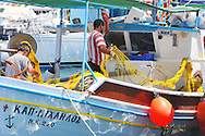 Colorful working fishing boats in the Greek Islands.  Photographed in Ios, Mykonos and Syros.