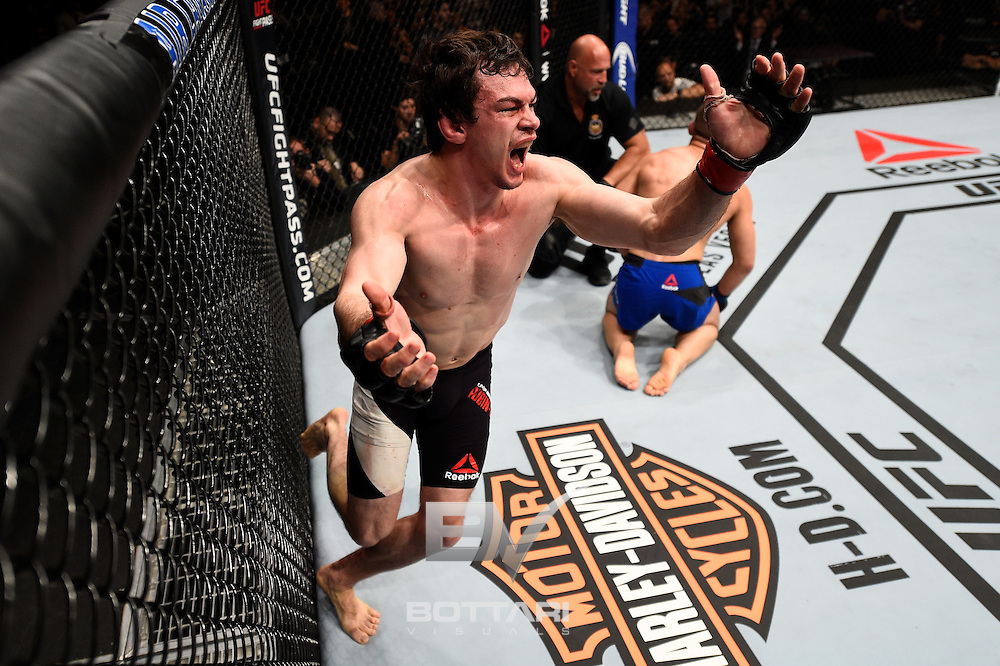 TORONTO, CANADA - DECEMBER 10:  Olivier Aubin-Mercier of Canada celebrates after his submission victory over Drew Dober in their lightweight bout during the UFC 206 event inside the Air Canada Centre on December 10, 2016 in Toronto, Ontario, Canada. (Photo by Jeff Bottari/Zuffa LLC/Zuffa LLC via Getty Images)