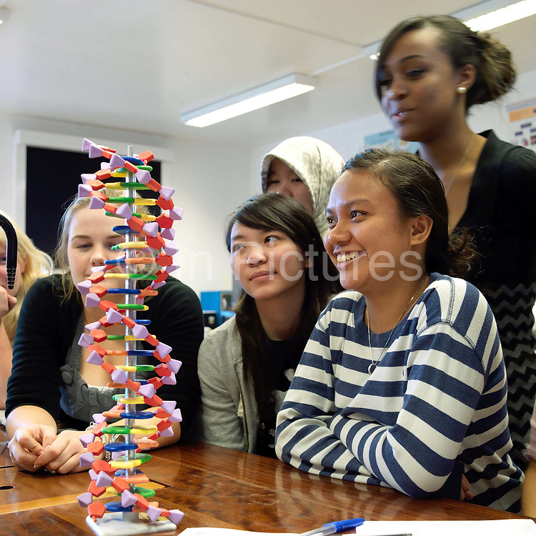 Teenage girls enjoying a science lesson at The Mount School, York, UK. The Mount School is a Quaker independent day and boarding school in York, England, for girls aged 11–18. It was founded in 1785.
