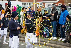 Slough, UK. 28th April 2019. Young Sikhs demonstrate 'gatka', an ancient form of Sikh martial art, during the Vaisakhi Nagar Kirtan procession. Vaisakhi is the holiest day in the Sikh calendar, a harvest festival marking the creation of the community of initiated Sikhs known as the Khalsa.
