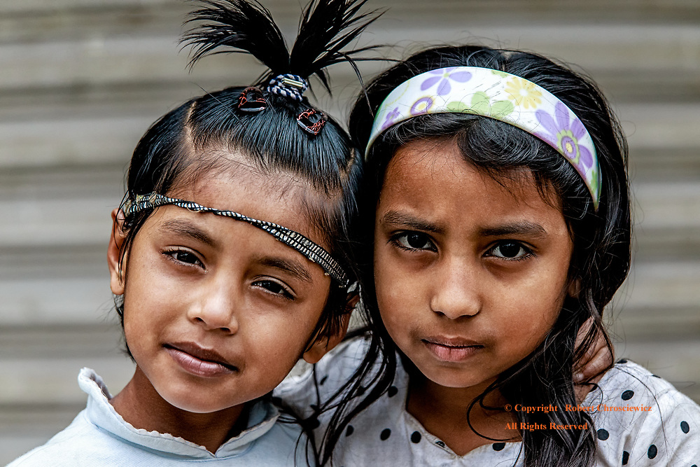 Young Best Friends: Two young girls are the best of friends and readily bring their heads together for a photograph in Srimangal Bangladesh.