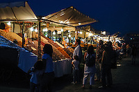 Morocco, Marrakesh. Jemaa el Fna is a square and market place in Marrakesh's medina. Juice sellers.