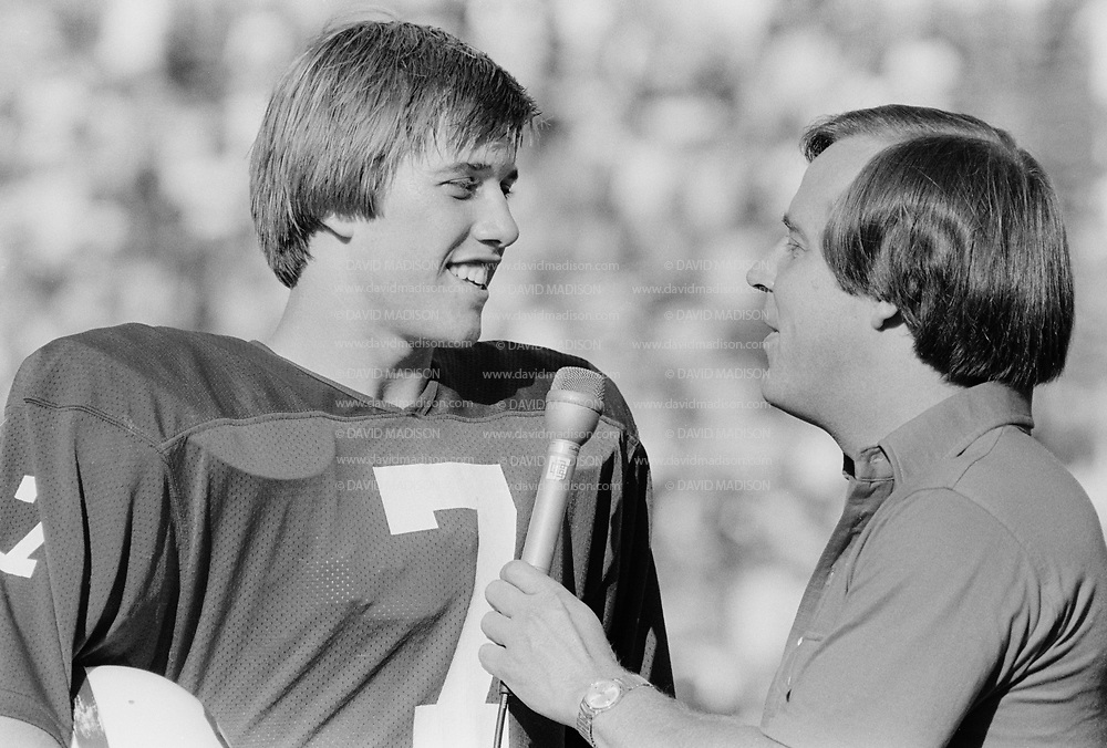 John Elway being interviewed by Ron Barr following Nov 1979 Stanford - Boston College game at Stanford Stadium