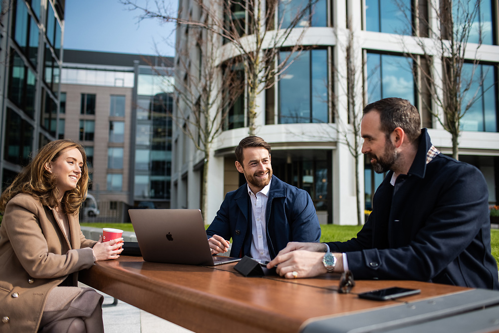 Colleagues working outside the International Finance Centre in the business district of St Helier, Jersey, CI