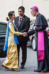 NO FRANCE - NO SWITZERLAND: May 4, 2017 : State Counsellor and Union Minister for Foreign Affairs of the Republic of the Union of Myanmar Aung San Suu Kyi, left, is welcomed by Prefect of the Pontifical Household, Archbishop Georg Ganswein, upon her arrival at the Vatican for a private audience.