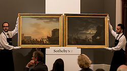 "© Licensed to London News Pictures. 06/07/2016. London, UK.  ""Le Soir, a pair"" by Claude-Joseph Vernet, which sold for a hammer price of GBP2.4m (est 3-5m) at Sotheby's Old Masters evening sale in New Bond Street. Photo credit : Stephen Chung/LNP"