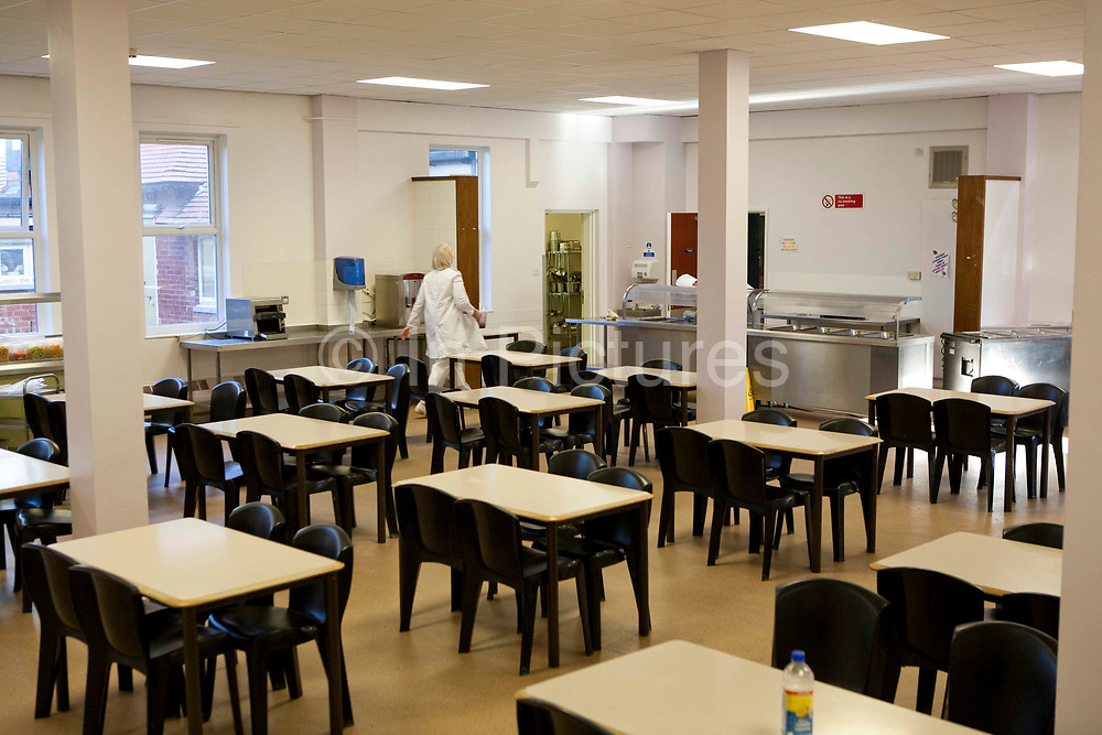 The main prisoner dining room HMP Askham Grange, a women's open prison. HM Prison Askham Grange is a women's open category prison, located in Askham Richard village in North Yorkshire, England. The prison is run by Her Majesty's Prison Service. Askham Grange accepts adult females and female young offenders, and has space for ten mothers to maintain full-time care of their child or children whilst in custody. Inmates tend to have already served three years or more in other prisons, and are transferred to Askham Grange to complete the last part (maximum three years) of their sentence. Because of this the prisons main focus is the re-integration and re-settlement of prisoners into the community and preparation for life after prison. Accommodation in the prison consists mainly of dormitories, though there are some single rooms. All prisoners in the Mother and Baby unit have their own rooms. The prison's education department mainly concentrates on vocational skills, and many prisoners are given work-placements outside the prison as part of their re-settlement plan.