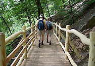 Bear Mountain, New York - Hikers walk across a 28-foot bridge on a newly rebuilt section of the Appalachian Trail during National Trails Day at Bear Mountain on June 5, 2010. A ceremony and hike celebrated the reconstruction of this original section of the Appalachian Trail. More than 800 volunteers, along with professionals, built 800 hand-hewn rock steps and a broad, gently sloping trail bed atop nearly a mile of rock wall.