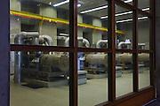 Nederland, Zeeland, Neeltje Jans, 16-04-2009; Ir. J.W. Topshuis, interieur van het Dienstgebouw Stormvloedkering Oosterschelde: elektriciteitscentrale bestaande uit een serie dieselgeneratoren; de kering heeft twee van deze centrales en is daardoor onafhankelijk van het landelijk elektriciteitsnet<br /> Bij het testen tijdens een zgn. noodsluiting moet de centrale automatisch opstarten en koppelt het systeem zichzelf los van het landelijk net. Bij de noodsluiting wordt de kering door het computergestuurde besturing systeem volledig automatisch gesloten (het syteem wordt voor de gek gehouden door het handmatig omhoog draaien van de vlotters die de waterstand meten).<br /> Ir. J.W. Tops House, interior of the Service Building Oosterschelde storm surge barrier: power plant consisting of a series of diesel generators, the barrier has two of these plants and is thus independent of the national electricity network<br /> When testing a so-called emergency closure, the computerized control system automatically starts the generators and dicsconnetcts from the national network. During the emergency closure test, the system is fooled by manually turning up the floats that measure the water height)<br /> foto/photo Siebe Swart