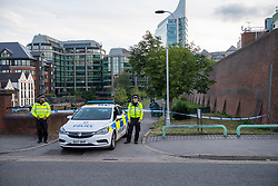 © Licensed to London News Pictures. 20/06/2020. Reading, UK. Police maintain a cordon. Police on site at Forbury Gardens Gardens in Reading responding to reports of a stabbing. Police and paramedics responded on mass to the incident including at least two air ambulances. Photo credit: Peter Manning/LNP