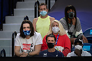 Serena Williams of the U.S.'s husband Alexis Ohanian, coach Patrick Mouratoglou, sister Venus Williams and other team members watch from her player box during a quarterfinal match against Romania's Simona Halep at the 2021 Australian Open at Melbourne Park in Melbourne, Australia.