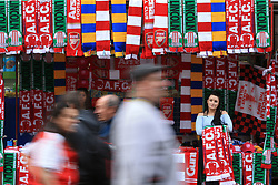 11 March 2017 - The FA Cup - (Sixth Round) - Arsenal v Lincoln City - Fans pass a stall selling scarves bearing the fixture date - Photo: Marc Atkins / Offside.