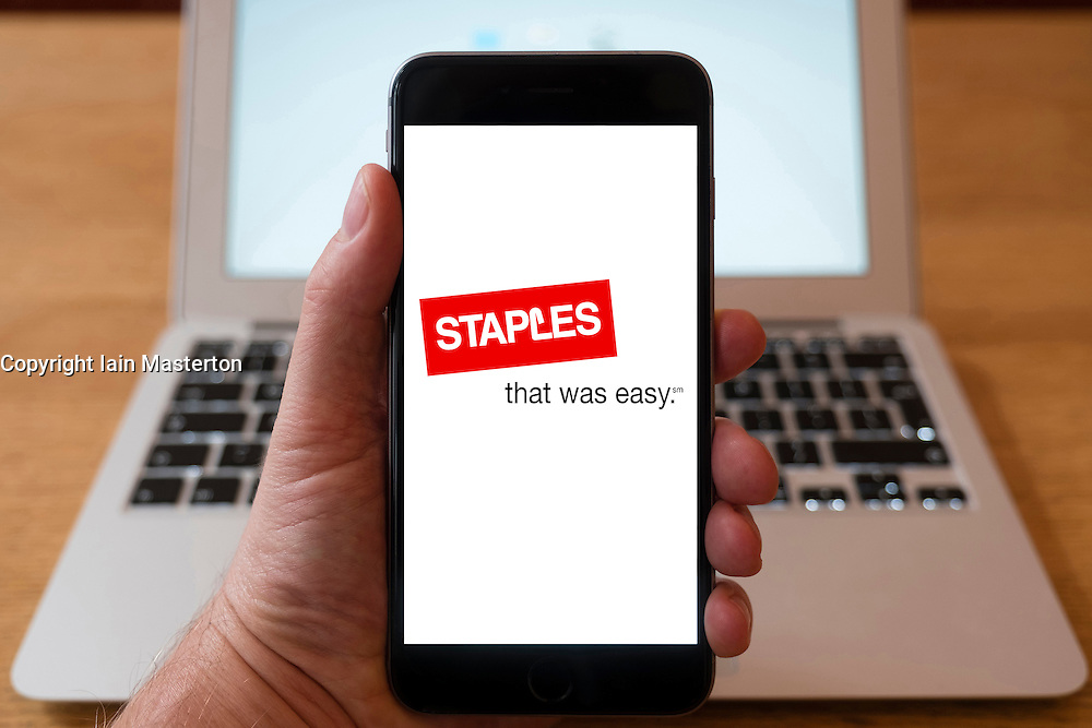 Using iPhone smartphone to display logo of Staples office supplies chain of stores