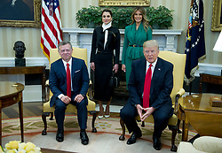 United States President Donald J. Trump meets King Abdullah II of Jordan in the Oval Office of the White House in Washington, DC on Wednesday, April 5, 2017.  Standing behind the King and President are Queen Rania of Jordan, left, and first lady Melania Trump. (Photo by Ron Sachs/Pool/CNP) *** Please Use Credit from Credit Field ***