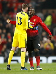 Crystal Palace goalkeeper Wayne Hennessey (left) and Manchester United's Romelu Lukaku embrace after the final whistle