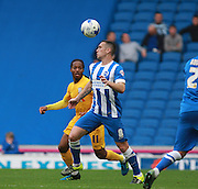 Brighton central midfielder Andrew Crofts looks to control a high ball during the Sky Bet Championship match between Brighton and Hove Albion and Preston North End at the American Express Community Stadium, Brighton and Hove, England on 24 October 2015. Photo by Bennett Dean.