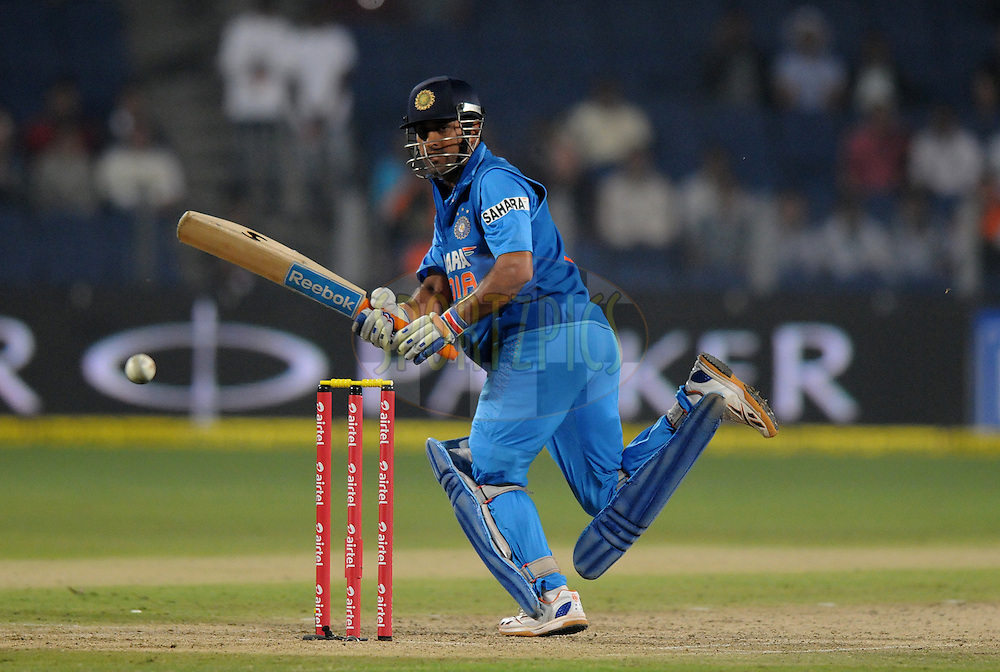 MS Dhoni captain of India bats during the first Airtel T20 Match between India and England held at Subrata Roy Sahara stadium in Pune on the  20th December 2012..Photo by  Pal Pillai/BCCI/SPORTZPICS .