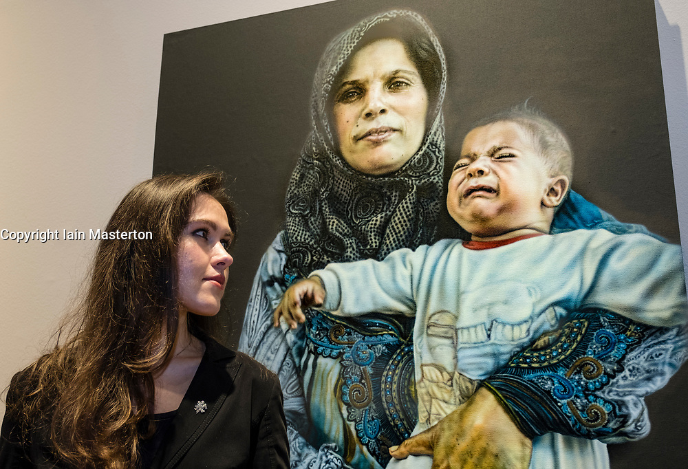 Edinburgh, Scotland, United Kingdom. 14 December, 2017. <br /> <br /> Artist Laura Guoke poses beside her painting Portraits from the Ritsona Refugee Camp at  The BP Portrait Award 2017 which  opens at the Scottish National Portrait Gallery on 16 December 2017.