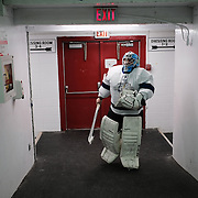 A member of the Ochiichagwe'Babigo'Ining Ojibway Nation (also known as the Dalles First Nation) getting ready for a game of ice hockey with friends at the Recreation Centre in the town of Kenora, about 30 minutes drive from the nation's reserve, on 15 December 2016.