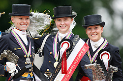 Prize giving Young Riders Kür  : <br /> 1. Sanneke Rothenberger (GER)<br /> 2. Annabel Frenzen (GER)<br /> 3. Cathrine Dufour (DEN)<br /> European Championship Dressage Young Riders - Broholm 2011
