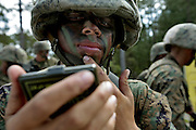 A recruit applies some camo paint during the Crucible.  The Crucible is A 52 hour final test in their recruit training and represents the culmination of all of the skills and knowledge a marine should possess. Marine Corps Recruit Depot at Parris Island in South Carolina is where all male recruits living east of the Mississippi River and all female recruits from all over the US receive their arduous twelve week training in their quest to become marines. Even though there are two current active wars and a weak economy, recruitment has not been effected.  Actually, recruiting numbers have increased, with more young men and women looking toward the military for answers.