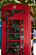 Unused telephone kiosk box in London street turned into a greenhouse full of plants on 15th September 2019 in Archway, London, United Kingdom. The red telephone box, a telephone kiosk for a public telephone designed by Sir Giles Gilbert Scott in 1926. In 2006 the K2 telephone box was voted one of Britains top 10 design icons.