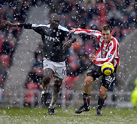 Photo: Jed Wee.<br />Sunderland v Fulham. The Barclays Premiership. 08/04/2006.<br />Sunderland's Chris Brown (R) looks on take on Fulham's Papa Bouba Diop.