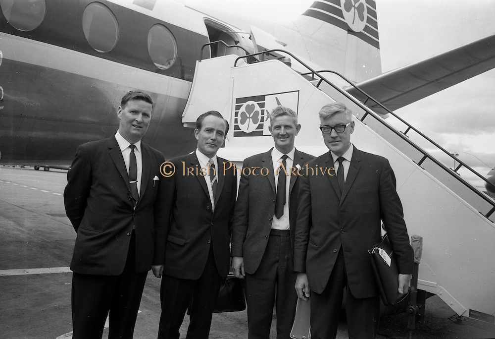 16/07/1967<br /> 07/16/1967<br /> 16 July 1967<br /> Fishermen leave on market research visit to Britain from Dublin Airport. Representatives from Killybegs, Dingle; Kilmore Quay and Castletownbere went on the trip to Fleetwood and Grimsby. Image shows (l-r): Mr F. Downey, Fishermen's Co-operative, Castletownbere; Mr T.F. Geoghegan Market Development Manager of BIM; Mr. D. O'Driscoll, Fishermen's Co-operative, Castletownbere and Mr J.M. O'Connor (front right) the Board's Advisory Services Manager about to board the plane to England.