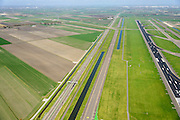 Nederland, Noord-Holland, Haarlemmermeer, 09-04-2014; luchthaven Schiphol. Rijksweg A5, parallel aan de 36C, de Zwanenburgbaan (vierde baan), start- en landingsbaan.<br /> Schiphol Airport, runway 36C.<br /> luchtfoto (toeslag op standard tarieven);<br /> aerial photo (additional fee required);<br /> copyright foto/photo Siebe Swart.