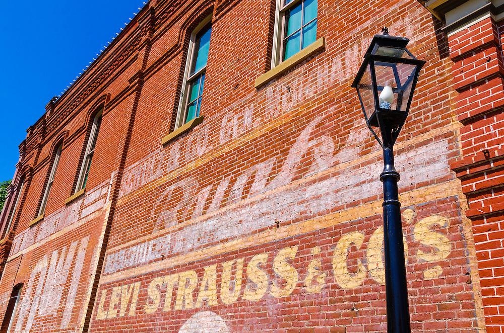 Historic advertisement on red brick building, Jacksonville, Oregon USA
