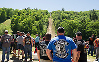 Crowds gathered at the base of the 70 meter jump for Motocycle Week's Hill Climb at Gunstock on Wednesday.  (Karen Bobotas/for the Laconia Daily Sun)
