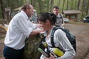 Laz records times as Beverly Anderson-Abs and her husband Alan check out at the yellow gate during the Barkley Marathons.