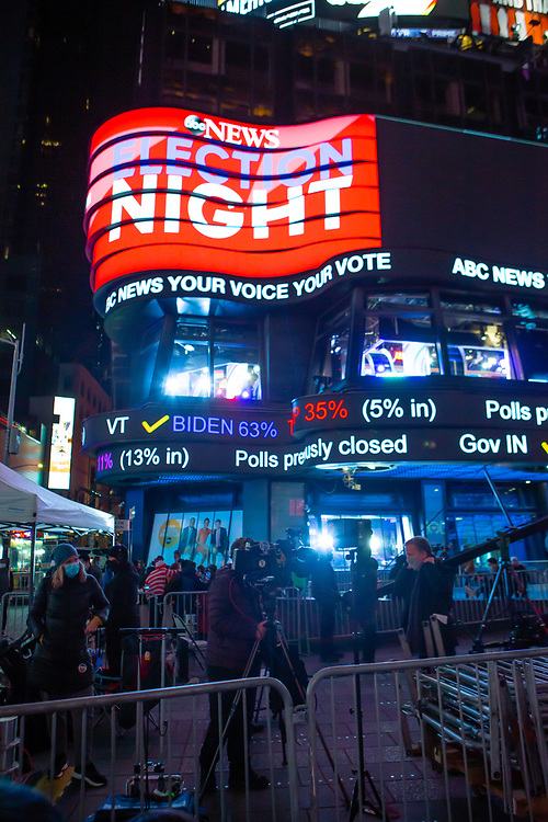 New York, NY - 3 November 2020. New York City anticipates presidential election results as polls in some states close. The ABC News studio in Times Square announces preliminary election results as TV crews set up in the Square as crowds arrive.
