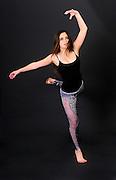 Young female teen of thirteen modern dancer On black Background