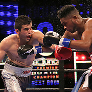 WINTER PARK, FL - AUGUST 02:  Jorge Cota of Sinaloa, Mexico (L) lands a left hook to the face of  Yudel Jhonson of Havan, Cuba, during the Premier Boxing Champions on Bounce TV boxing match at Full Sail University - Ebbs Auditorium on August 2, 2015 in Winter Park, Florida. Cota won the bout by unanimous decision. (Photo by Alex Menendez/Getty Images) *** Local Caption *** Yudel Jhonson; Jorge Cota