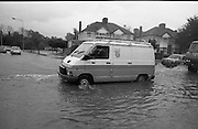 """Flooding at the Dodder..1986..26.08.1986..08.26.1986..28th August 1986..As a result of Hurricane Charly (Charlie) heavy overnight rainfall was the cause of severe flooding in the Donnybrook/Ballsbridge areas of Dublin. In a period of just 12 hours it was stated that 8 inches of rain had fallen. The Dodder,long regarded as a """"Flashy"""" river, burst its banks and caused great hardship to families in the 300 or so homes which were flooded. Council workers and the Fire Brigades did their best to try and alleviate some of the problems by removing debris and pumping out some of the homes affected..Note: """"Flashy"""" is a term given to a river which is prone to flooding as a result of heavy or sustained rainfall...Image of telecom workers heading out to effect repairs to systems damaged by the flood."""