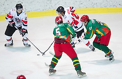 Emilio Romig and Christoph Herzog of Austria vs Lukas Manomaitis and Marius Cerniauskas of Lithuania  during the ice hockey match between National teams of Lithuania (LTU) and Austria (AUT) at 2011 IIHF World U20 Championship Division I - Group B, on December 12, 2010 in Ice skating Arena, Bled, Slovenia.  (Photo By Vid Ponikvar / Sportida.com)
