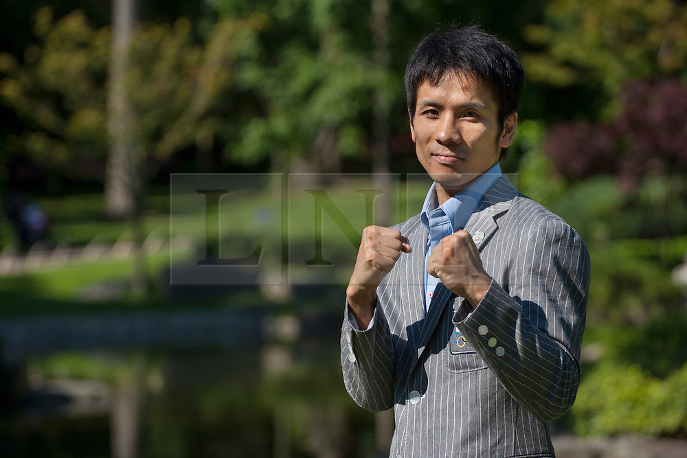 © licensed to London News Pictures. London, UK 24/07/2012. Japanese Olympic boxer Katsuaki Susa posing at the Fukushima Garden opening ceremony in Holland Park, London. 27 year-old boxer will be fighting for men's fly in the Olympics. Photo credit: Tolga Akmen/LNP
