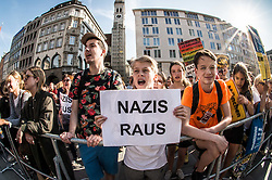 April 28, 2018 - Munich, Bavaria, Germany - A group of the counter-demonstrators with a sign that translates to 'nazis out'. Pegida founder returned to Munich for a repeat of last month's march through one of the most-traveled portions of the city. Last month, just a few hours after Bachmann's appearance in Munich, he was arrested at London-Stansted airport. (Credit Image: © Sachelle Babbar via ZUMA Wire)